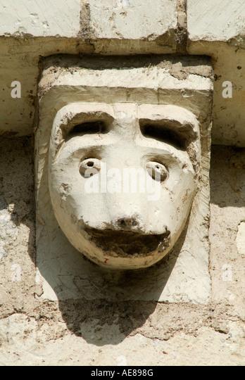 Carved stone grotesque stock photos