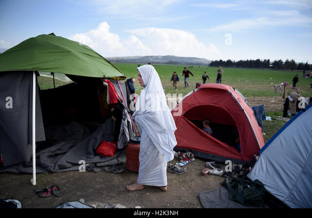 A refugee woman walks outisde a tent at the refugee c& in the northern Greek & Women Walk In Tent Camp Stock Photos u0026 Women Walk In Tent Camp ...