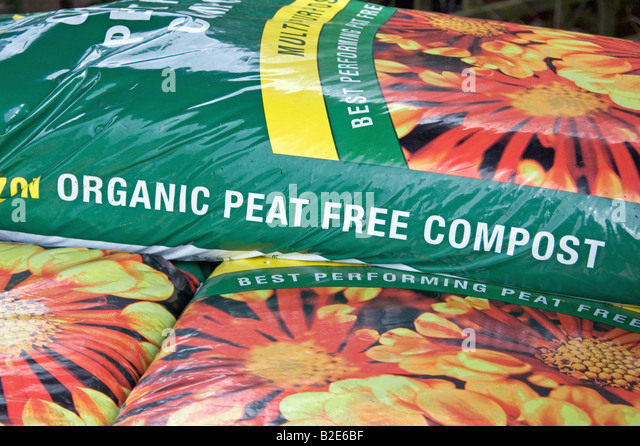 organic peat free compost for sale in garden centre stock image