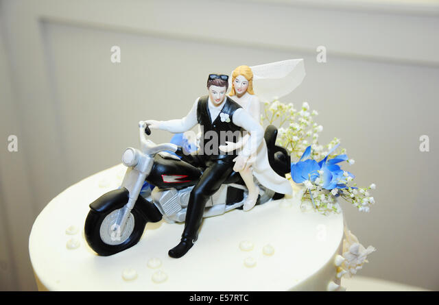 A Creative Biker Couple Adds Motorcycle Wedding Topper To Their Cake During Alternative