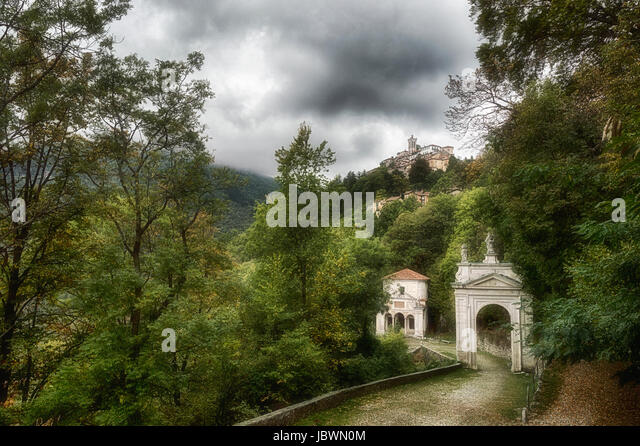 Sacred Mount of Varese in a cloudy afternoon of september with green forest and grey sky - Lombardy, Italy - Stock Image