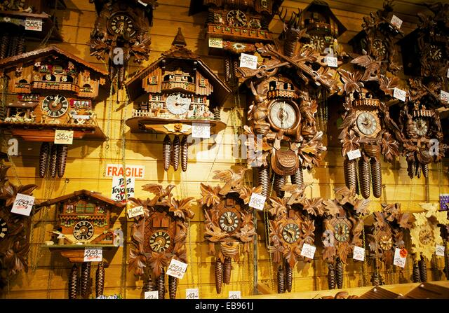 cuckoo clocks for sale in a french souvenirs shop stock image