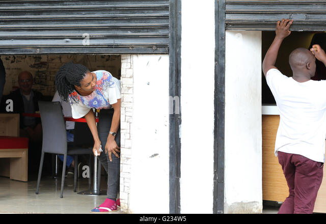 Nairobi Kenya. 23rd May 2016. Owners of a resturant try to close & Scores On The Doors Stock Photos u0026 Scores On The Doors Stock ... pezcame.com