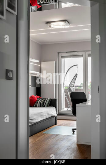 Modern interior design room for teenagers - view from corridor - Stock Image