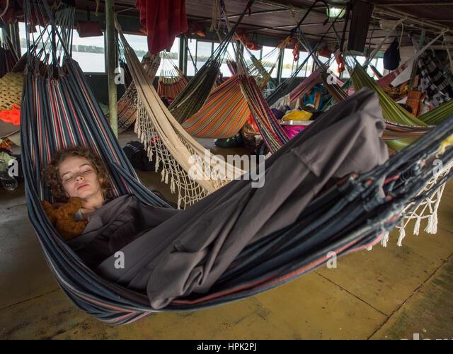 amazon river peru   may 13 2016  young woman is resting on hammocks amazon boat hammock stock photos  u0026 amazon boat hammock stock      rh   alamy