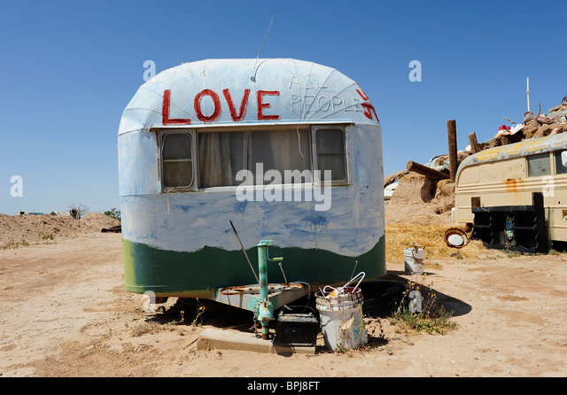Caravan Or Mobile Home Painted With Religious Slogans Located At Salvation Mount Slab City