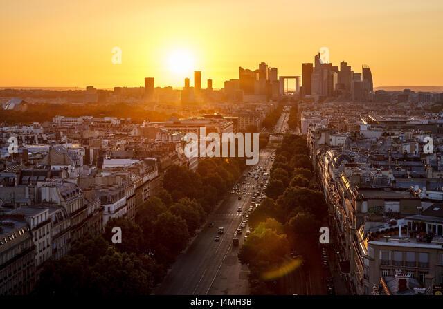 Avenue de la Grande Armee and La Defense neighborhood in Paris at sunset. France - Stock Image