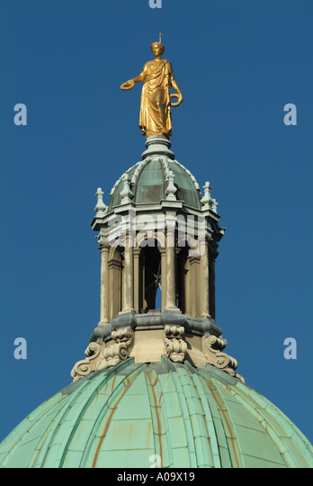 statue of the greek goddess of victory on top of the dome of the hbos