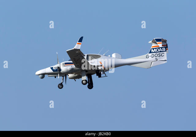 Diamond DA-42 MPP Guardian [G-DOSC] equipped with surveillance equipment landing runway 31. - Stock Image