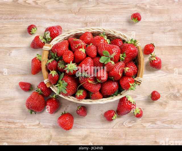 Fresh strawberry in basket on wooden background. Top view. High resolution. Harvest concept - Stock Image