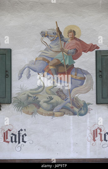 Lüftlmalerei piece Georg on the horse fights against the bad dragon on a house facade in Schliersee, - Stock Image