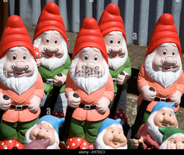 Amazing Colourful Garden Gnomes Lined Up For Sale, UK   Stock Image