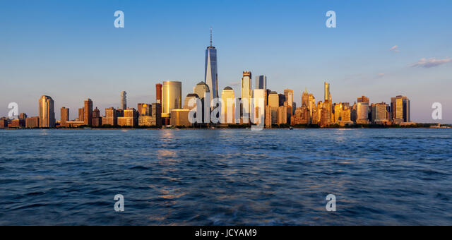 Panoramic of New York City Financial District skyscrapers at sunset - Stock Image