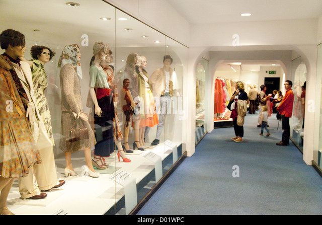 A family looking at dresses in the fashion Museum  Bath Somerset UK   Stock  ImageBath Fashion Museum Stock Photos   Bath Fashion Museum Stock  . Bath Fashion Museum Gift Shop. Home Design Ideas