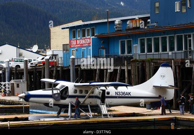 http://l7.alamy.com/zooms/7f371376e85841679ece90b9741294d9/a-blue-and-white-sea-plane-on-a-dock-in-juneau-alaska-d3t7ng.jpg