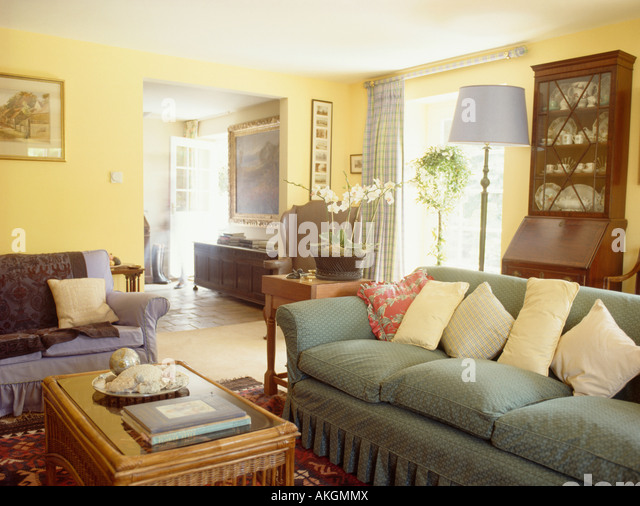 Interiors livingroom traditional pastel stock photos for Yellow green living room