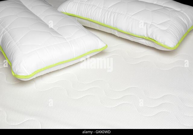 closeup of orthopedic mattress and pillows stock image