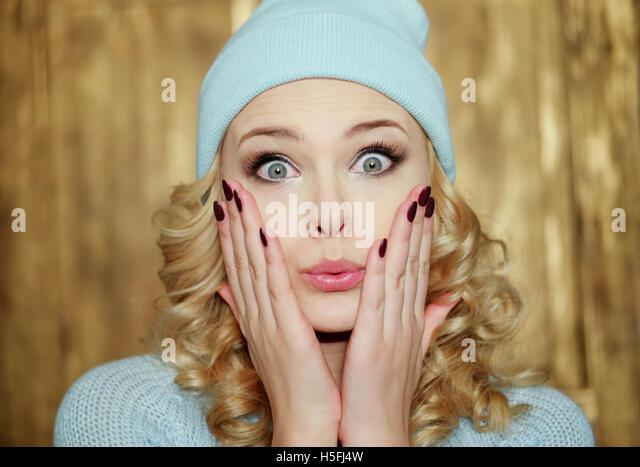 Woman hiding face hat stock photos amp woman hiding face hat stock