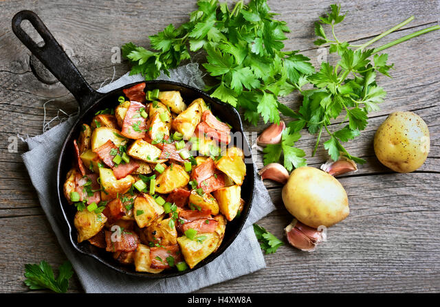 Fried Potatoes With Bacon And Green Onion On Wooden Background Top View Stock Image