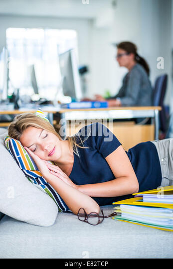 woman taking a nap in the office stock image business nap office relieve