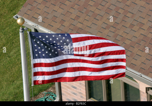 Us flag flying from building stock photos us flag flying from an american flag flying on a flag pole viewed from above the house stock image sciox Image collections