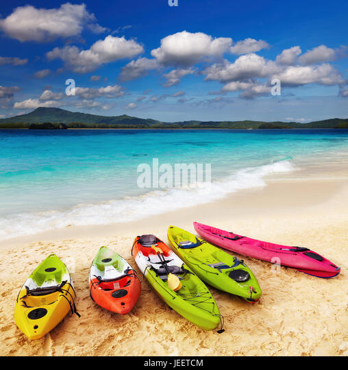 Colorful kayaks on the tropical beach - Stock Image