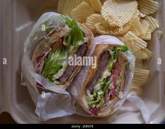 steak sandwich with potato chips stock image