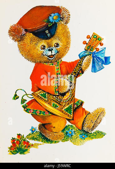 USSR - CIRCA 1989: Reproduction of antique postcard shows bear dressed in traditional red shirt (kosovorotka) plays - Stock Image