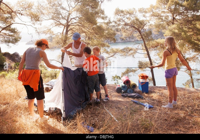 Croatia Dalmatia Family holidays on c&ing site pitching the tent - Stock Image : guy pitching a tent - memphite.com