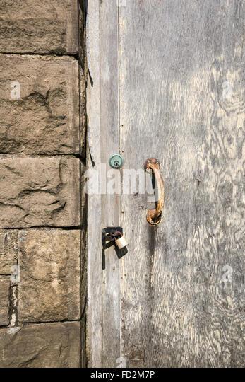 Old locked and padlocked door with peeling paint. - Stock Image & Old Locked Door Stock Photos \u0026 Old Locked Door Stock Images - Alamy Pezcame.Com
