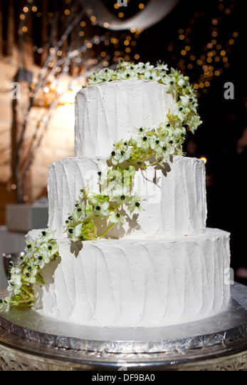 A Three Tiered Wedding Cake Decorated With Flowers