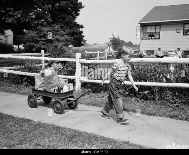 Boy Pulling Wagon : Jeans s stock photos images alamy