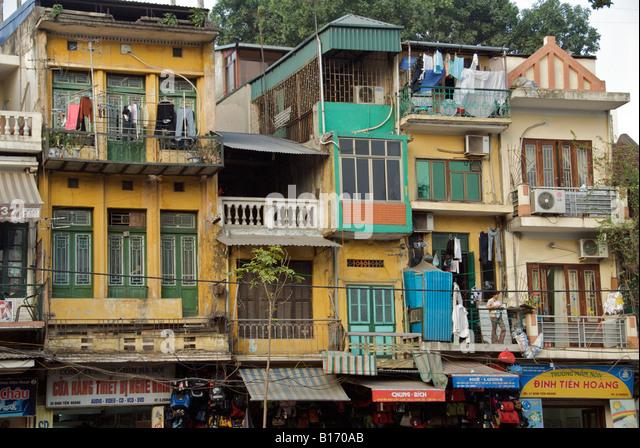 Facade shops and apartments Old Quarter Hanoi Vietnam - Stock Image