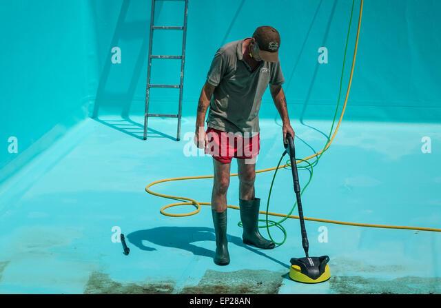 Man Jet Washing Patio Stock Man Jet Washing Patio Stock