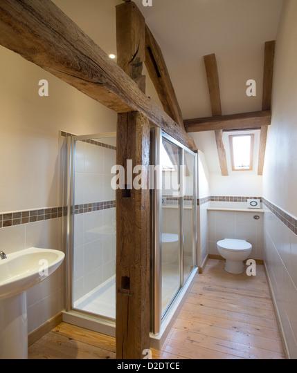 Restored house interior uk stock photos restored house for Barn conversion bathroom ideas