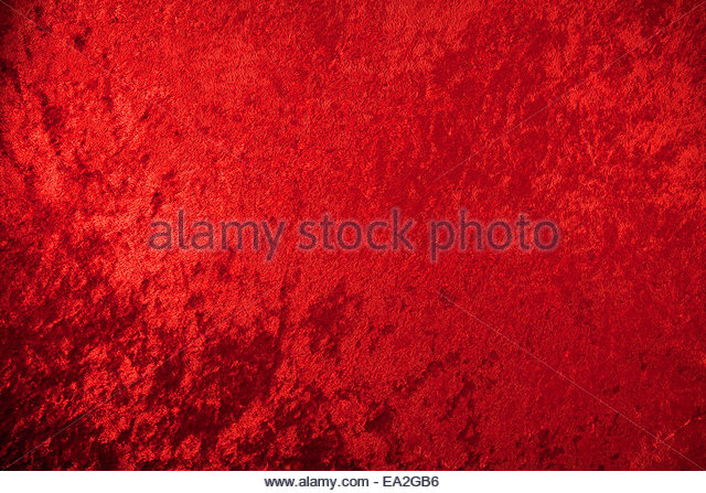 crushed red velvet as a background design element for christmas holiday stock image
