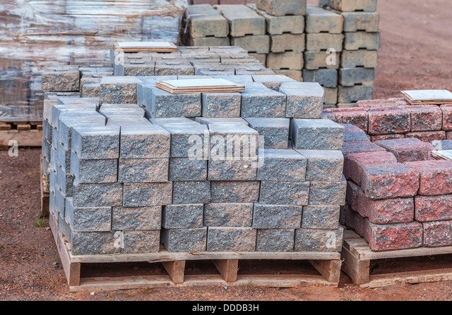 High Quality Stacks Of Various Colored Concrete Pavers (paving Stone) Or Patio Blocks  Organized On Wooden