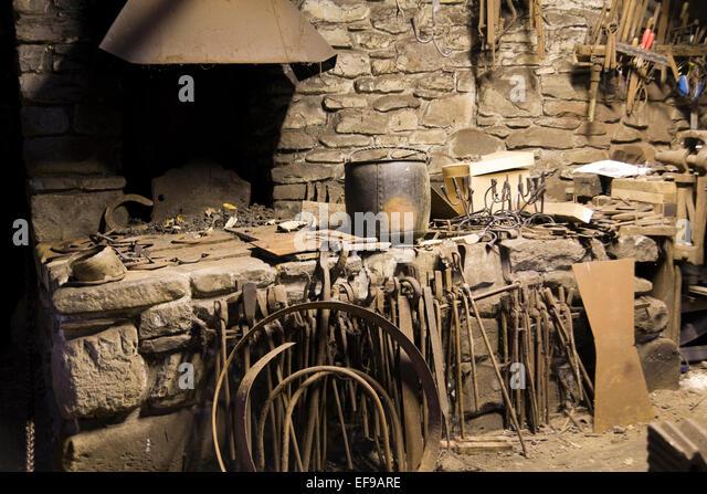 blacksmith workshop. inside an old working blacksmith workshop at british cultural centre - stock image s