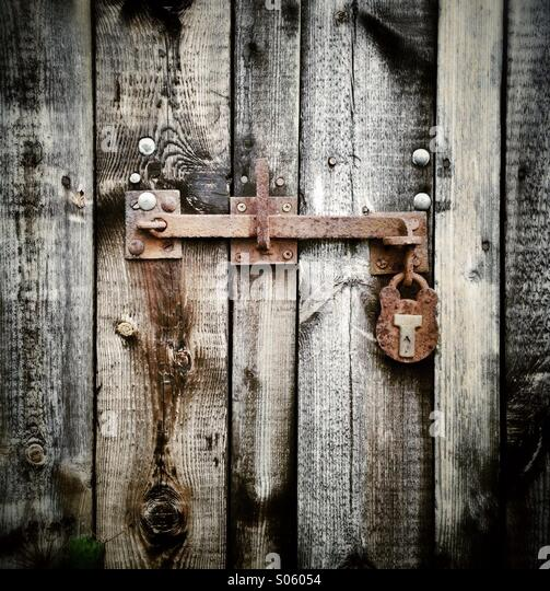 Rusty Bolt And Padlock On An Old Barn Door   Stock Image
