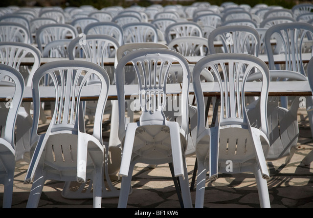 Plastic chairs and table stock photos plastic chairs and for Outdoor furniture yangon