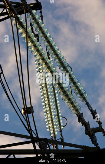 Insulators pylons power lines stock photos insulators for Power line insulators glass