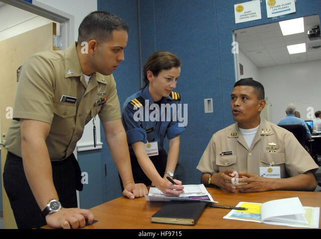 from right panamanian navy lt luis rodriguez discusses maritime strategy with canadian navy lt navy intelligence specialist