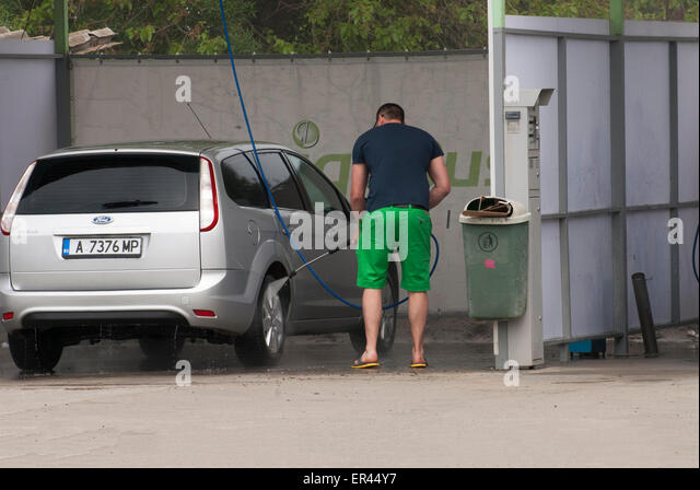 Car wash station stock photos car wash station stock images alamy a man washing his car at self service car wash station stock image solutioingenieria Gallery