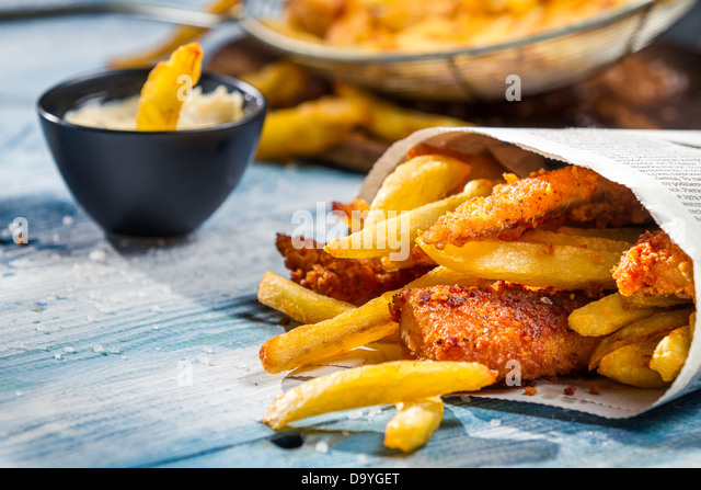 Fish and chips in paper stock photos fish and chips in for Fish and chips newspaper