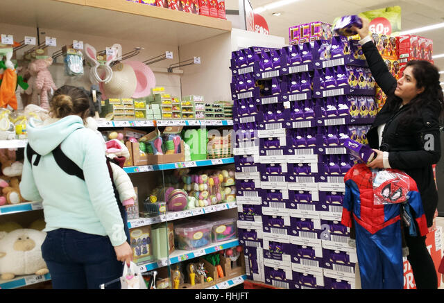 Lots of chocolates stock photos lots of chocolates stock images london uk 2 march 2016 a shopper in sainsburys store picks up an easter negle Choice Image