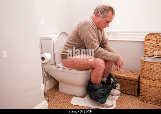 Sitting On Toilet Stock Photos & Sitting On Toilet Stock ...