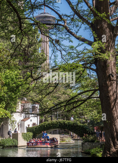 Tour boat and Tower of the Americas, River Walk, San Antonio, Texas. - Stock Image