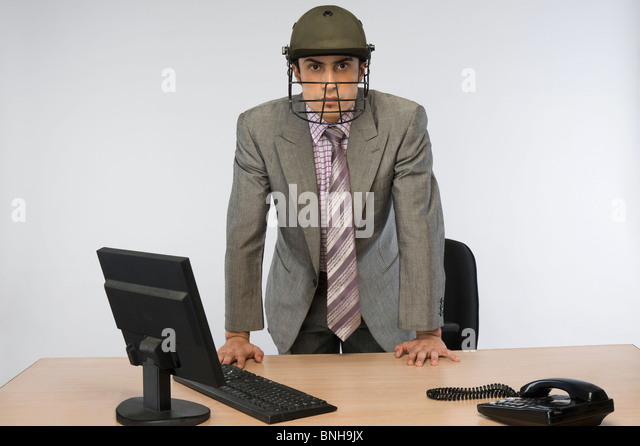 http://l7.alamy.com/zooms/839c230ca9ce4205aa1dd65681c46721/portrait-of-a-businessman-wearing-a-cricket-helmet-and-using-a-computer-bnh9jx.jpg
