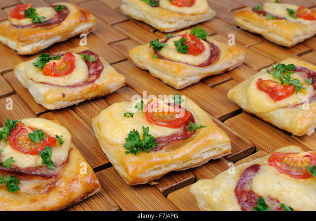 Appetizer puff pastry salami cheese stock photos for Puff pastry canape