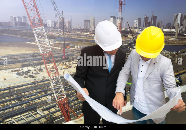 Consulting engineers stock photos consulting engineers stock management consulting with engineers working and holding blueprint engineer designer with helmet holding blueprint stock malvernweather Choice Image
